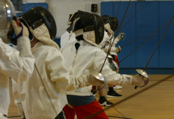 fencing-masks-on